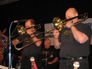 Two Allreds (Bill and John) and a Metz (Ed., Jr.) on trombones and drums