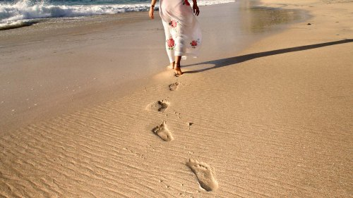 footprints-in-sand-at-beach